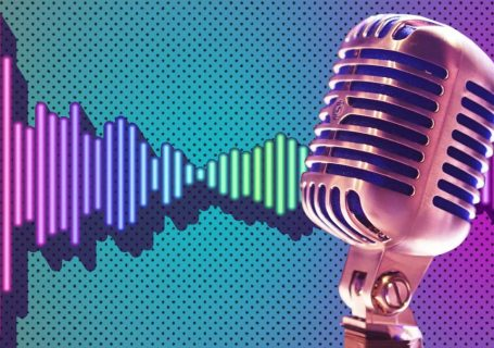 Retro microphone in front of brightly coloured audio waveform graphic